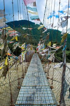 Buddhist prayer flags blowing in the wind, a common sight near Thimpu, Bhutan. Local people consider prayer flags lucky. They think everything touched by the the wind that passes through the prayer flags will be blessed.