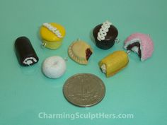 Set of Hostess dessert polymer clay charms next to a quarter for size comparison. For more information please visit www.CharmingSculptHers.com