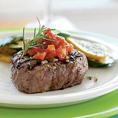 Fresh rosemary brings pleasant pine notes to grilled beef. If you don't have time to make the jam, use bottled tomato chutney instead. Extra rosemary sprigs make a lovely garnish.