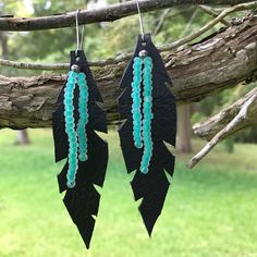 Hand cut black leather earrings with iridescent turquoise beads. #nativepearloeiginals
