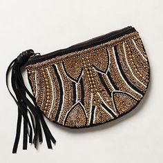 "Anthro ""Borneo Crescent Pouch"" Beautiful, like new clutch by Jasper & Jeera. Hand beaded. Genuine leather tassel zipper pull. I used this once and stowed it away in the closet. It's too nice to sit there! Excellent condition! Price firm no trades or Paypal! Anthropologie Bags Clutches & Wristlets"