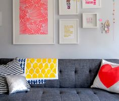 love the white frames, the prints & the grey couch