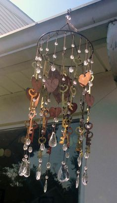 Wind chime made with crystals and hand cut flat shapes