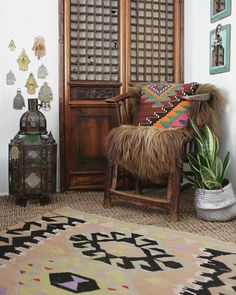 Decorate with layers. Layer on the rugs, pillows and faux fur! Don't forget the snake plant! Sweet nook from -  apartmentf15