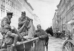 """Soviet stretcher bearers deliver a casualty to the """"ambulance"""" in Berlin, April 30, 1945."""