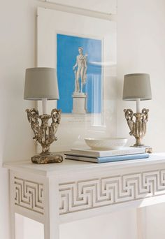 Fun Greek Key table...awesome vignette..great lamps and pop of turquoise.