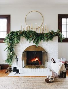 Asymmetrical garland: an unexpected take on traditional Holiday fireplace mantel decor. Hear my thought process and how to create the look at your house. christmas fireplace Asymmetrical Garland DIY - Francois et Moi Christmas Mantels, Christmas Home, Christmas Pajamas, Christmas Greenery, Christmas Fireplace Decorations, Mantle Greenery, Mantle Garland, Modern Christmas Decor, Greenery Garland