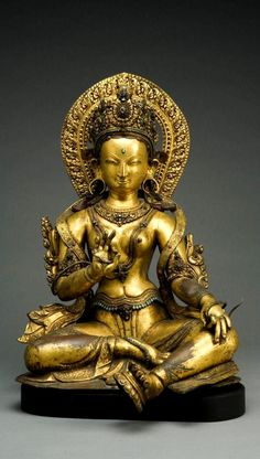 16th century, Nepalese Green Tara,  with a hand resting on her knee, holding the stem of a (broken) lotus.