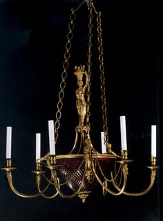 A Fine Russian Neoclassical Ormolu & Amber-Glass Figural Six-Light Chandelier, Possibly Swedish, Circa 1800. Wired for Electricity. Height: 42 Inches, Diameter 30 Inches. Approximate Value: $70,000.