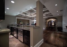 Basement wine room + media room, wet bar and game room