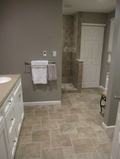 wide plank tile for bathroom. great grey color! great option if