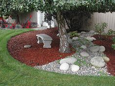 Different Ways to Use River Rock. This gave me inspiration for my mulch bed. I did a river rock border around it and I love it!
