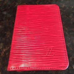 Auth Louis Vuitton Red Epi Leather Card Holder Date Code LO0941. In very good used condition, clean on inside and outside. 1 outside and 2 inside pockets. Approx 4 3/8 x 2 7/8 inches. See photos. Louis Vuitton Accessories Key & Card Holders