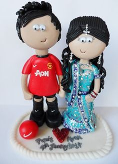Beautiful Asian Bride, Groom in Manchester United football kit! Personalised to look like the couple getting married, I can make anything you want! www.indian-wedding-cake-toppers.com or www.googlygifts.co.uk I ship anywhere in the World!