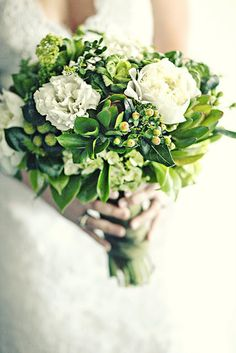 bouquet: green kale, brazilian berries, viburnum, safari sunset, boxwood, white peonies and lisianthis, green hydrangea, sprigs of rosemary