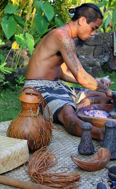 pounding taro into poi - a Hawaiian and Polynesian traditional staple food