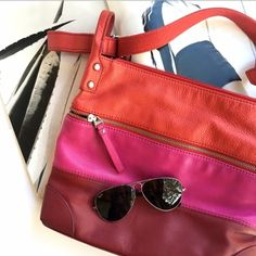 Fossil pink leather crossbody Super chic leather crossbody by fossil. Could be carried as a shoulder bag or a crossbody by adjusting strap. Some wear on corners but can be cleaned up otherwise great condition! 10.5x12.5 super roomy! Fossil Bags Crossbody Bags