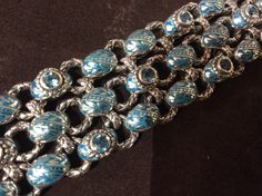 Details of a Sterling Silver, enamel and Swiss Blue Topaz bracelet handmade by #bowmanoriginals #enameljewelry # topazjewelry #handmadejewelry