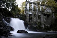 Abandoned Mill, Ontario. A waterfall with rickety bridge across might be creepy.