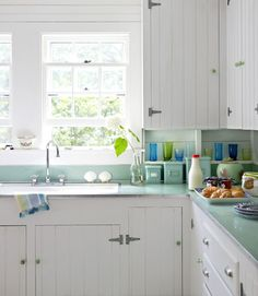 Cabinets from the 1930s get an easy update by adding beadboard doors plus new knobs and pulls.    Read more: Kitchen Designs - Pictures of Kitchen Designs and Decorating Ideas - Country Living