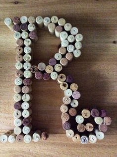 """My recent creation made from the corks of every bottle wine I've ever consumed; I had approx. 100 corks and have been saving them for about 20 years. I used almost all of them in this project.  Clearly I'm a cheap date if this is all I've drank in that much time!  I made this using hot glue and a wooden """"R"""" that I bought at Michaels to template it.  It took less than an hour and I did need to trim down some of the longer corks using a knife and cutting board (be careful!!)."""