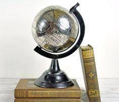 Silver world globe. So fancy I dropped my caviar.