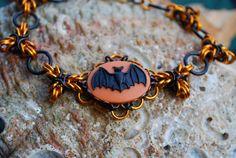 Spooky Black and Orange Bat Bracelet by GeekyGaeaDesigns on Etsy