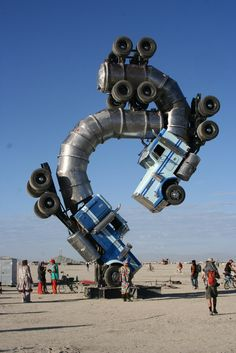 28 Big Rig Jig by Mike Ross, 2006 Photo by: Russ Atkinson  Big Rig Jig gathered a massive throng of eager Burners not only because of its poetic name, but because it is constructed from two giant tanker trucks, curving around each other while balancing on the Playa.