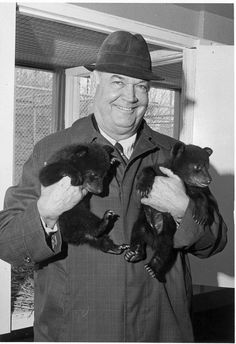 Former #Baylor President Abner McCall with a pair of bear cubs.