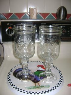 "These are a friends, she glued short candle sticks from Dollar Tree (with E9000 or a strong glue) to the bottom of some mason jars for some shabby chic wine ""goblets."" Cute for flowers too."