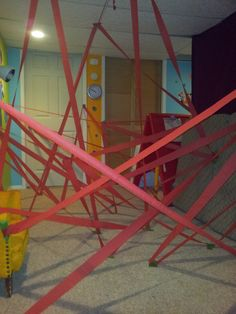 Fun rainy day activity for the kids (or Lego Ninjago Birthday party idea). Uses party streamers taped at different angles between walls, ceiling and floor. Lots of fun and a big success with ten 7-8 yr old boys.