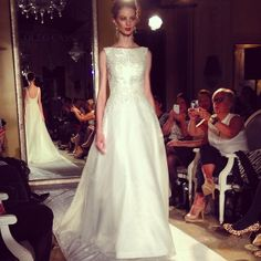 """Jackie O. elegance by Oleg Cassini for David's Bridal""- I kind of love the off the shoulder combined with the low back!"