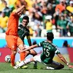 Arjen Robben (L) of the Netherlands competes for the ball against Rafael Marquez (C) and Hector Moreno (R) of Mexico