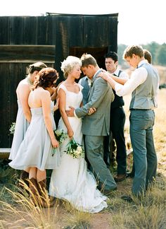 Having the bridal party pray over the new husband and wife, great idea!