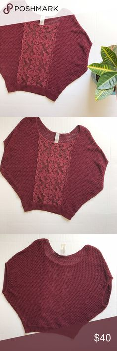 Free People Lace Front Dolman Sweater Lace front Dolman Sweater from Free People. Size: XS. Color: Maroon. Gorgeous Dolman sleeved Knit Sweater with sheer Lace panel in the front. 68% cotton, 21% nylon. Length: 22 inches. Free People Sweaters