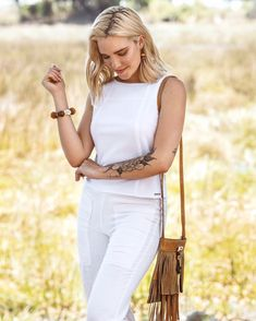 Simply sophisticated 🤍🌼🤍 One of our classics, the Ida Top now available online Wildlife Safari, Wildlife Conservation, African Safari, African Fashion, White Jeans, Classic, Pants, Instagram, Tops
