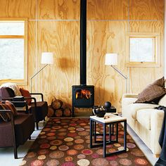 Fir plywood gives this home a warm look for less than standard wood paneling. The metal wall grids neatly hide the rough-cut edges.