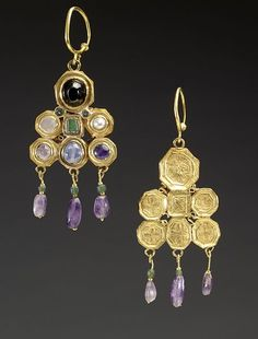 These dramatic, colorful earrings were most likely made in Constantinople, perhaps as an imperial gift to a Visigothic ruler of medieval Spain, where the earrings were found. The Visigoths, a migratory group that ultimately settled in Spain, had by the 6th century established trade and diplomatic contacts with the Byzantine court, whose jewelry they much admired. Date: circa 600 (Early Medieval)