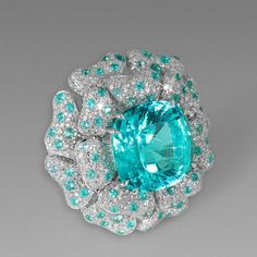 @davidmorrisjeweller Mozambique Paraiba Reef ring, set with 17.22ct Paraiba-like tourmalines and diamonds in white gold.  Locked away beneath the harsh, dry scrubland of north-eastern Brazil was a Paraiba tourmaline of such extraordinary colour that, when it made its debut at the Tucson Gem Show in 1990, the tantalising ocean-like, green-blue gem sent buyers into a frenzy - driving up the price from hundreds to thousands of dollars per carat within days. The Paraiba tourmalines discovered in the Brazilian outpost of São José da Batalha, and two subsequent sites in neighbouring Rio Grande do Norte, were electric in colour, almost neon; a never-before-seen quirk of nature created by a high copper content.  Source:@thejewelleryed