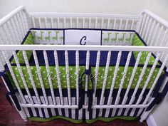 Navy and green crib bedding with giraffes