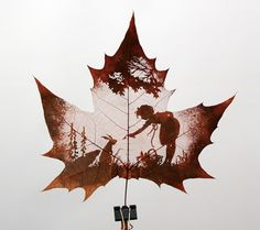 Natural leaf carving is actual manual cutting and removal of a leafs surface to produce an art work on a leaf. The process of carving is performed by artists using tools to carefully remove the surface without cutting or removing the veins.