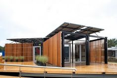 composed of two 40' shipping containers set together with a raised mid section and clerestory windows. The discarded shipping container home was built for a couple who wanted to live debt free on their property outside of San Jose, Costa Rica. A simple skewed arrangement of th
