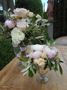 Rustic chic altar arrangements with olive and peonies   Tuscany wedding flowers
