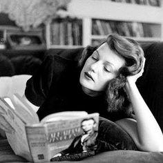 Rita Hayworth reading. With perfect hair.