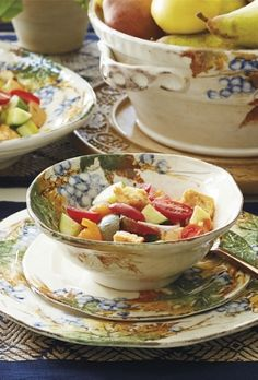 Hand painted grapevines, inspired by the picturesque vineyards of the historic Umbria region in central Italy, embellish this beautiful set of dinnerware.