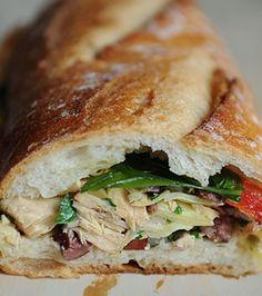 Le French Tuna Salad Sandwich - baguette loaf - garlic clove - basil leaves - tuna - kalamata olives - red bell pepper - red onion - Italian flat leaf parsley - fresh green beans - lemon - extra virgin olive oil