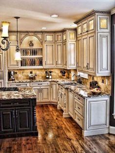 Tuscan kitchen design immediately conjures images of Italy and sunlight and warmth. In fact these kinds of images are just what you need to think of when coming up with the perfect Tuscan kitchen design. Tuscany a region in north… Continue Reading → Kitchen Backsplash Designs, Tuscan Kitchen, Home Decor Kitchen, Beautiful Kitchens, Floor Tile Design, Rustic Kitchen Cabinets, Rustic Kitchen, New Kitchen Cabinets, Kitchen Renovation