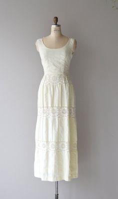 Vintage 1970s cream textured cotton blend maxi dress with wide necklace and wide set shoulder straps, tiny cotton lace trim, fitted waist with wide