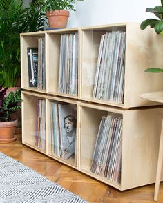 A stackable storage cube contains a collection of vinyl records. It has a clear plastic door, is modern in style, and is modular. Vinyl Record Storage Furniture, Vinyl Record Shelf, Record Rack, Record Cabinet, Vinyl Storage, Cube Storage, Vinyl Records, Record Player, Pallet Tv Stands