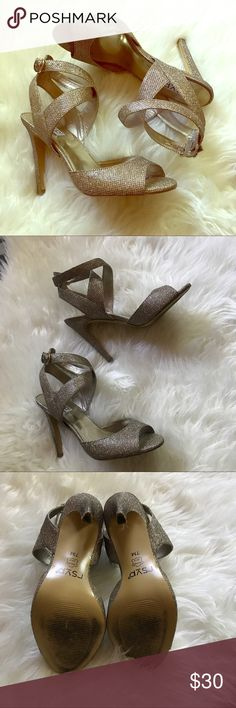 RSVP Gold Shimmer Strappy High-Heeled Sandals Worn at my wedding for 2 hours. I still love my husband so I'm certain they are good luck 😉🍀. They are in nearly new condition. Very shimmery and beautiful. I originally bought the shimmery Jimmy Choo's but returned for these because they were so comparable. Leather sole, fabric and synthetic upper. Approx. 4 inch heel. rsvp Shoes Sandals